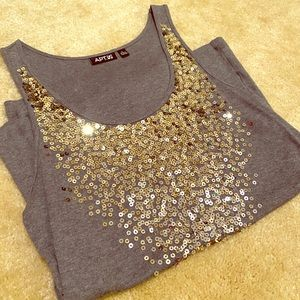 2/15$ Apt 9. Gray tank with gold sequins